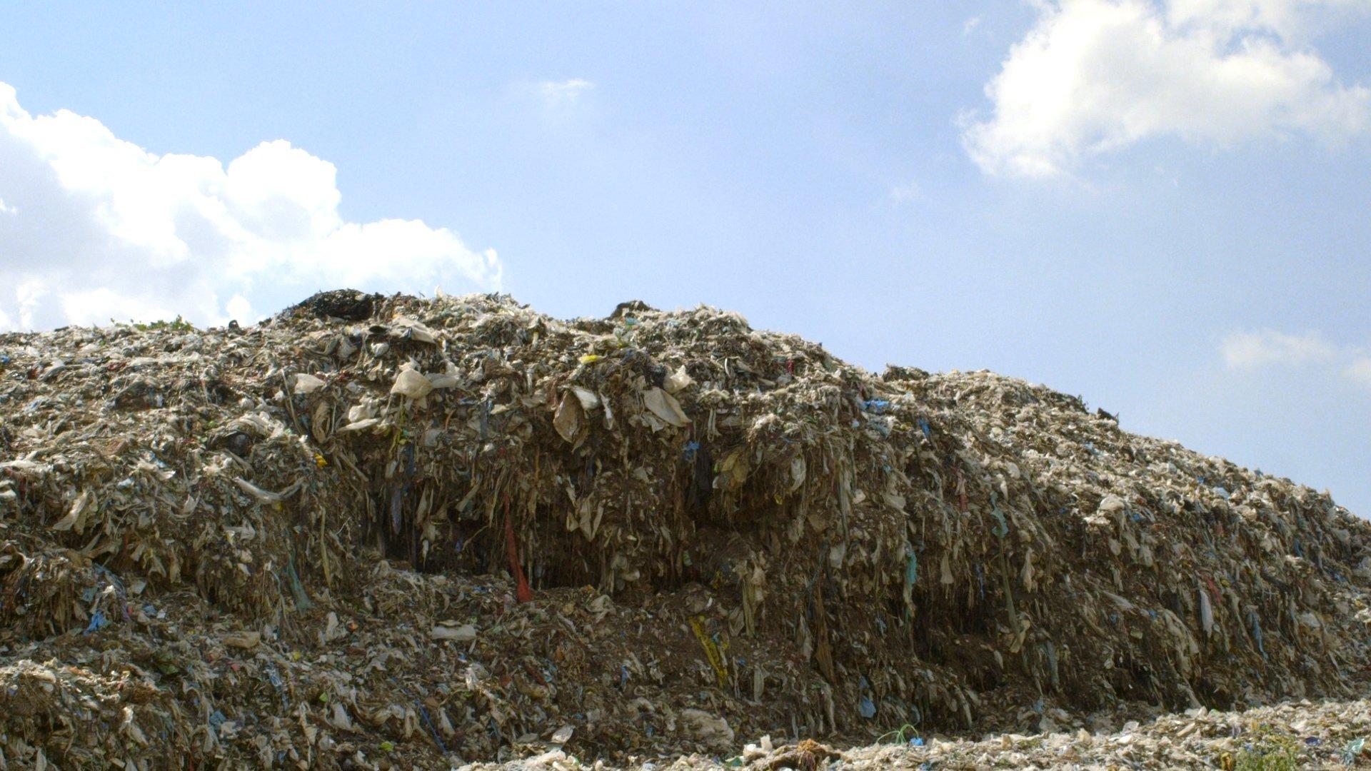 Scraps of clothes sitting in landfills.