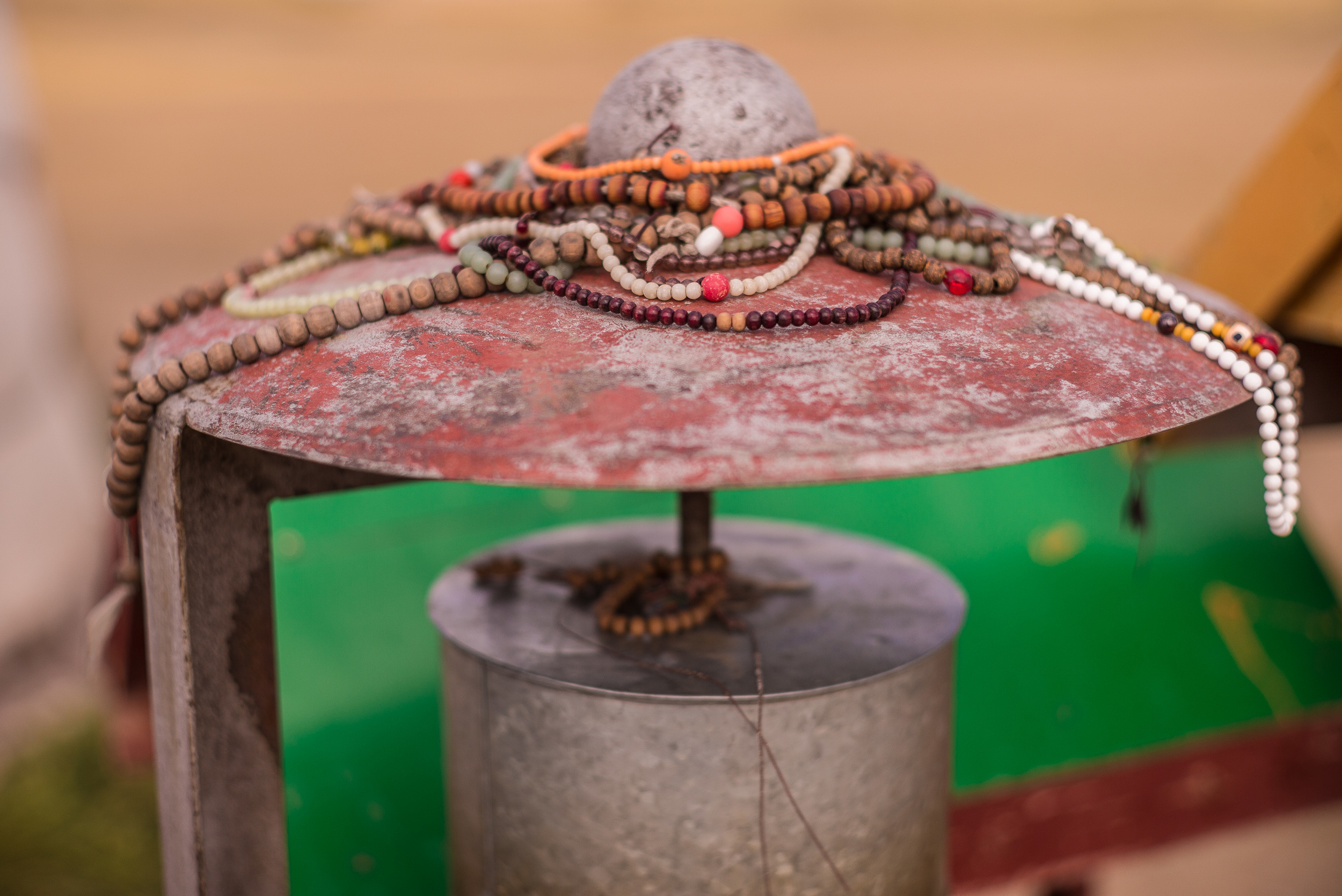 Mala beads left as offerings by supplicants