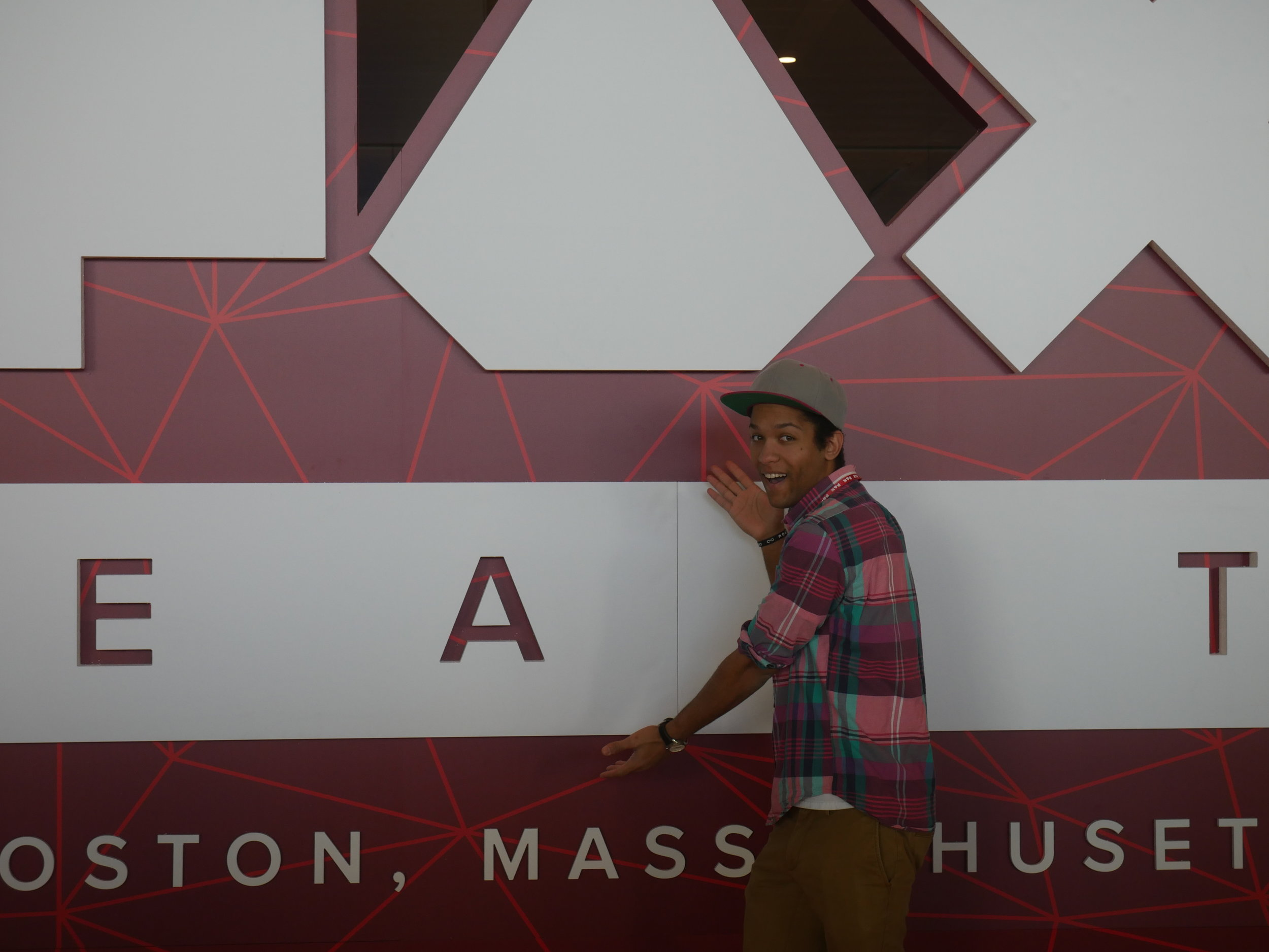 I strike a pose in front of the main PAX East sign.