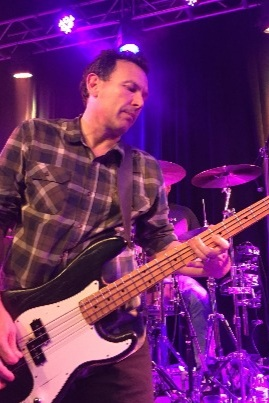 JORGE DE LA TORRE-BASS   He is in the band mainly because he laughs at Mike's jokes. Plus he has an REO Speedwagon hat.