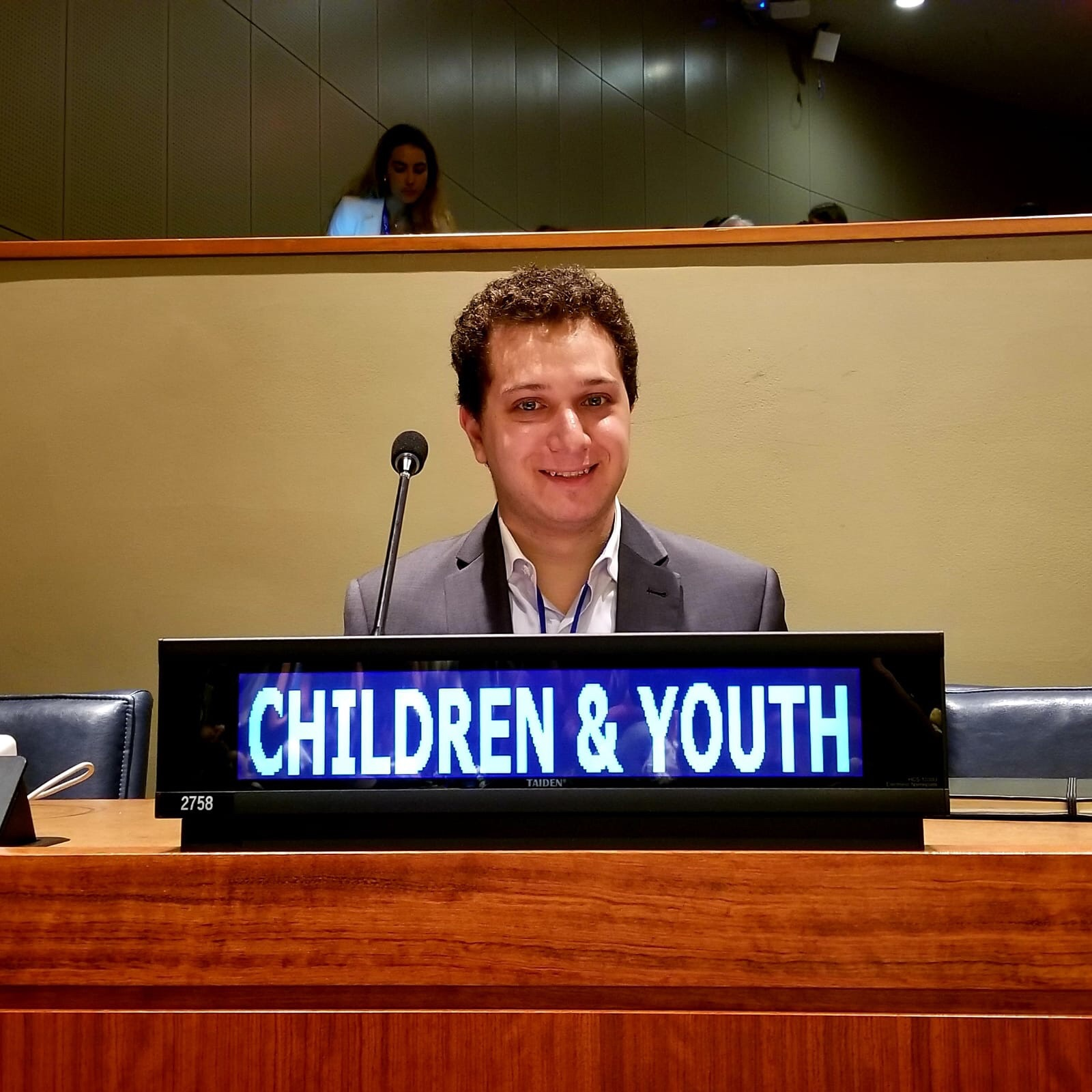 MPV UN Coordinator, Marwan Bishtawi, participates in the VNR sessions from behind the Children and Youth Major Group's seat.