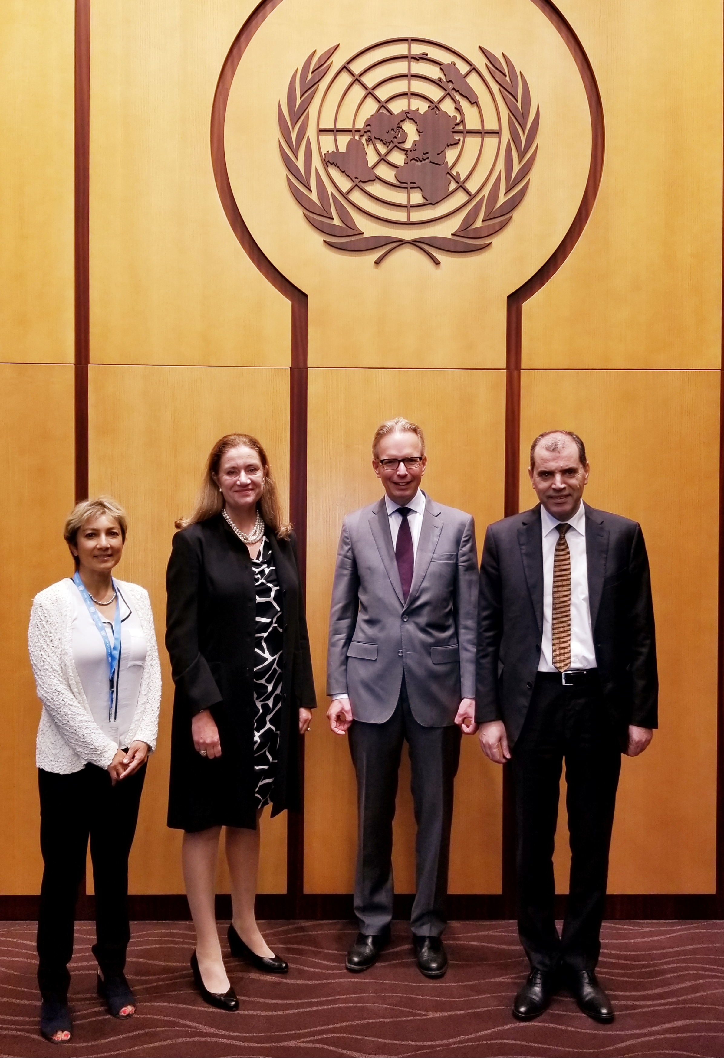 Ani Zonneveld stands with the Permanent Representatives of the Kingdom of the Netherlands, European Union, and Tunisia (from left to right).