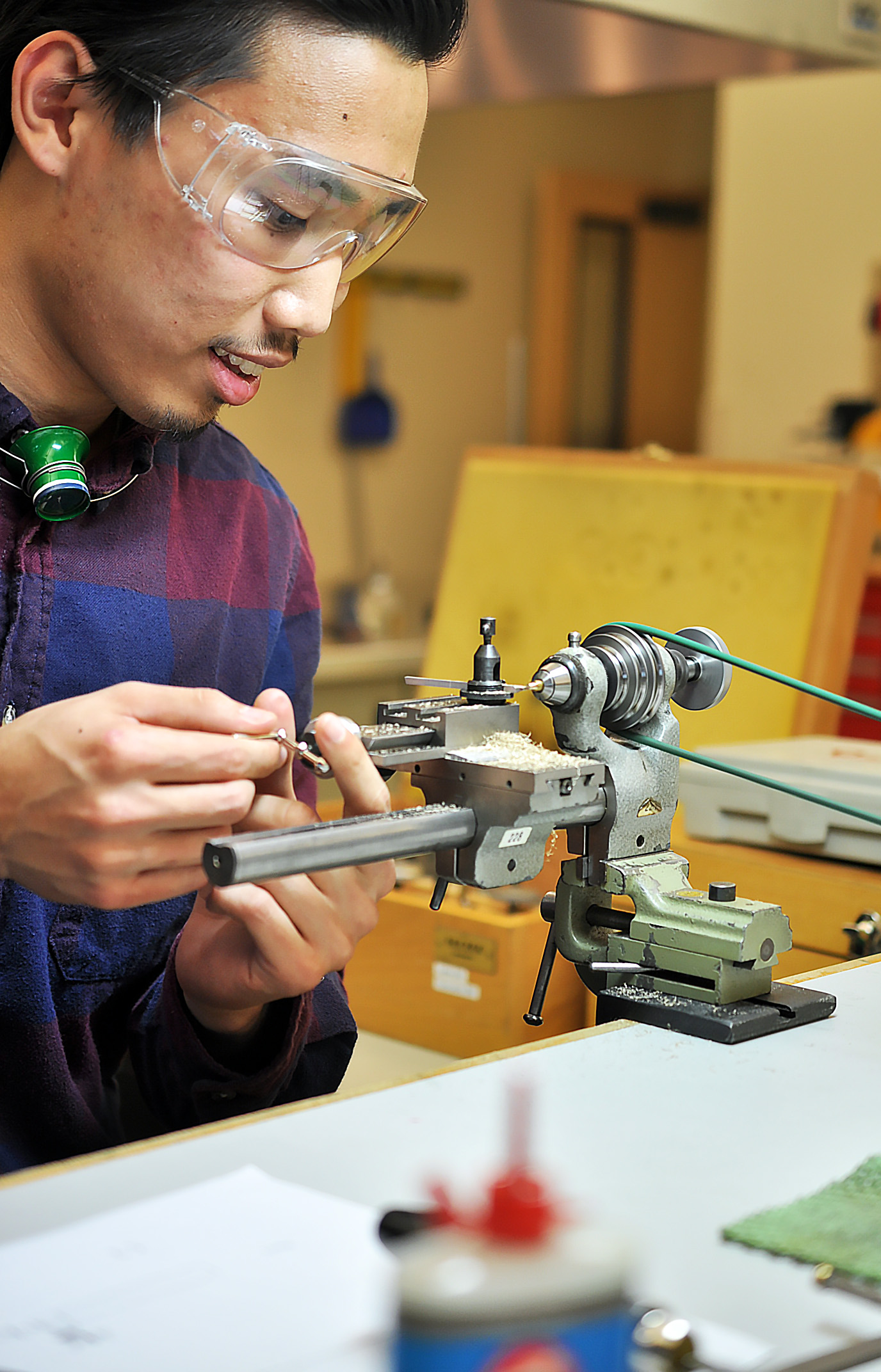 Max, a second year student, visits our side of the class to turn his handmade etachron tool on a lathe.