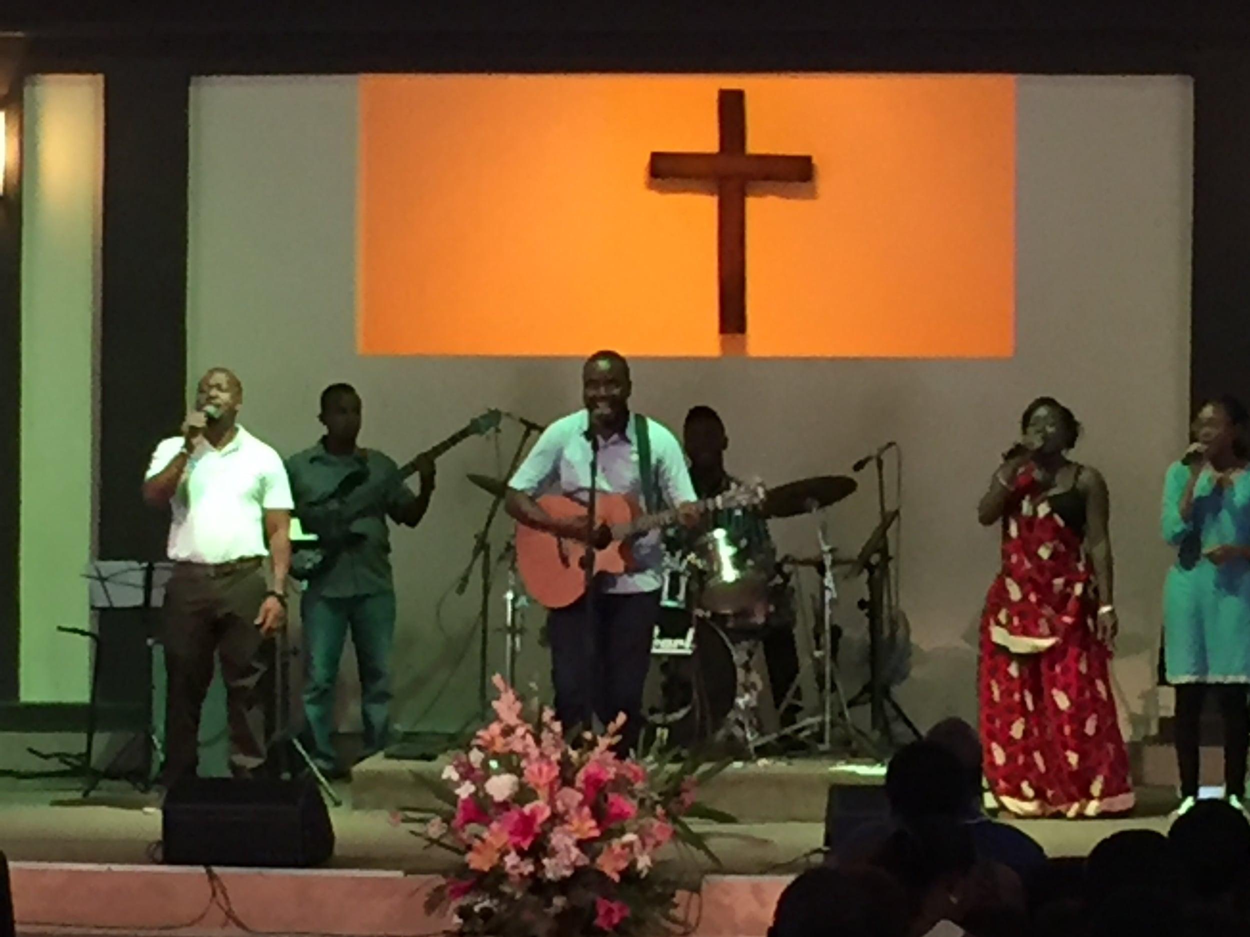 Pastor Robert leading worship