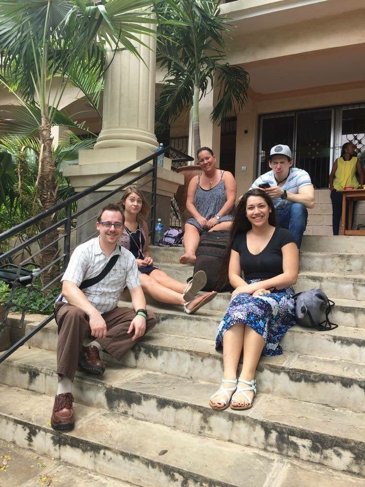 Relaxing on the steps of Crossroads Fellowship after the morning service.