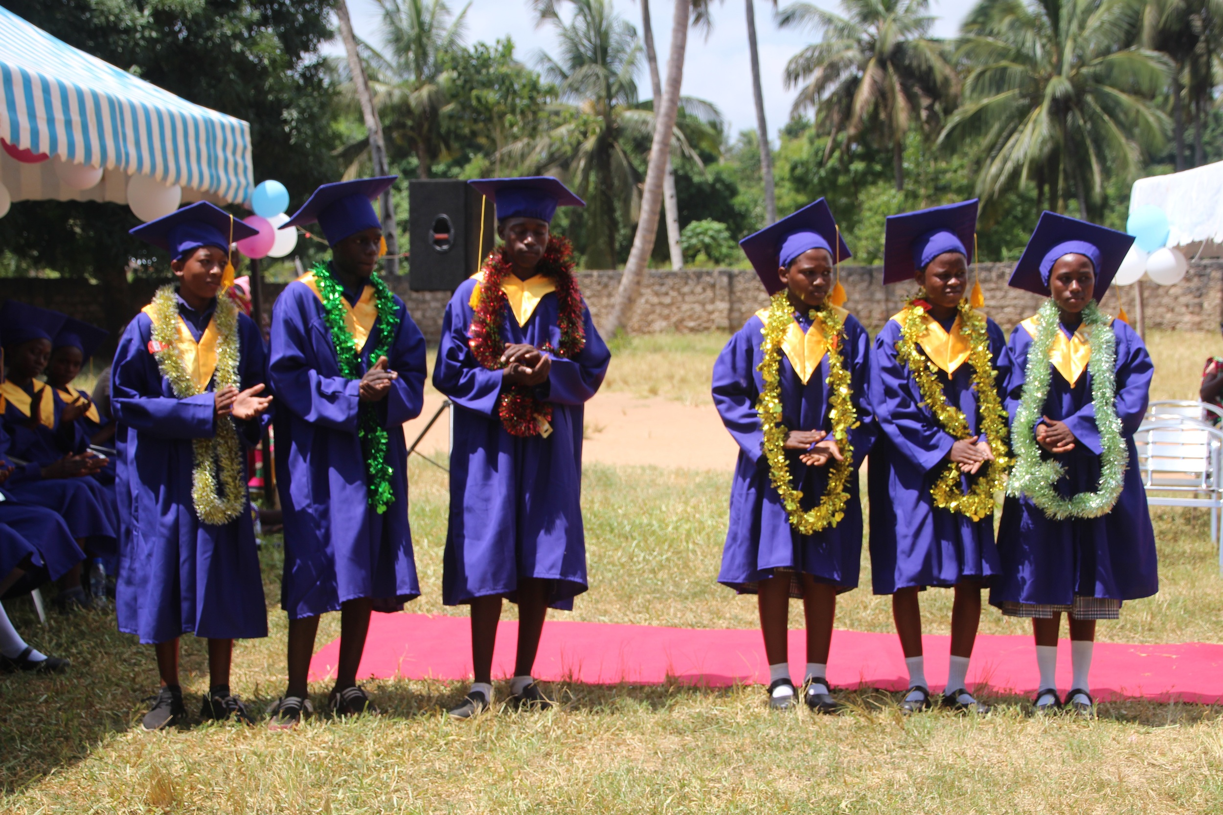 The students who received top scores on the KCPE were recognized and awarded.