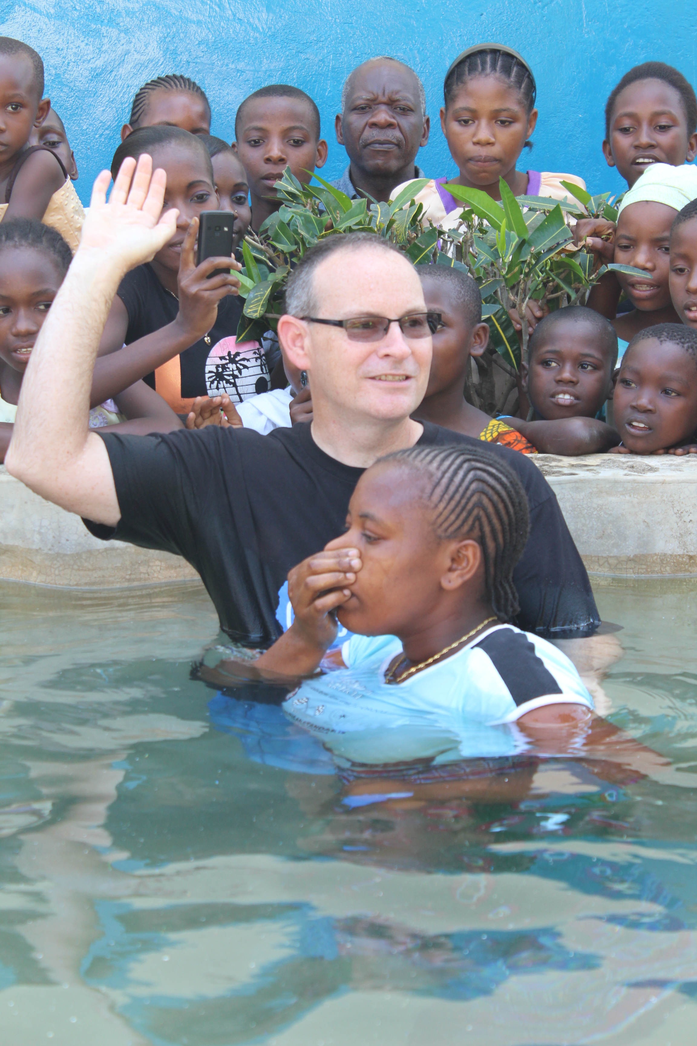 Bobby baptizing during a church service.