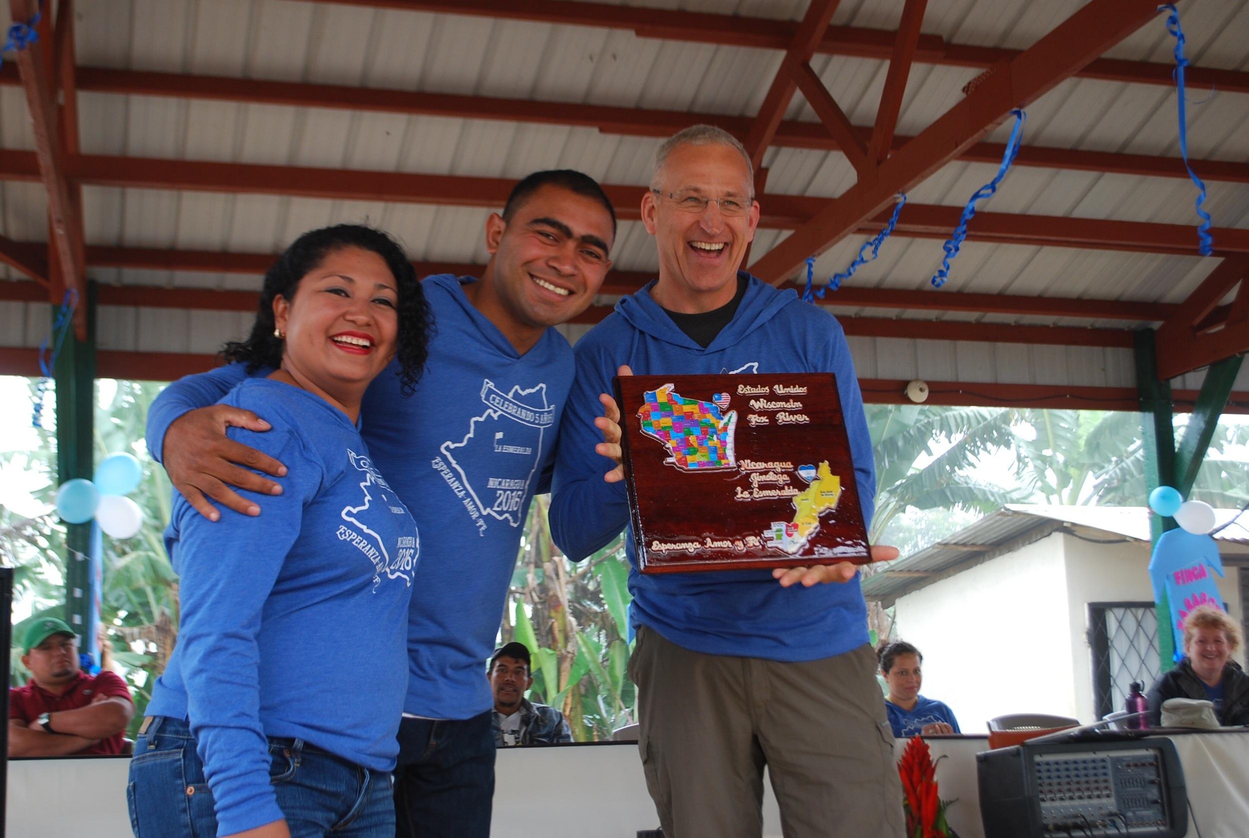 Pastor Denis and Karen honoring Fox River.