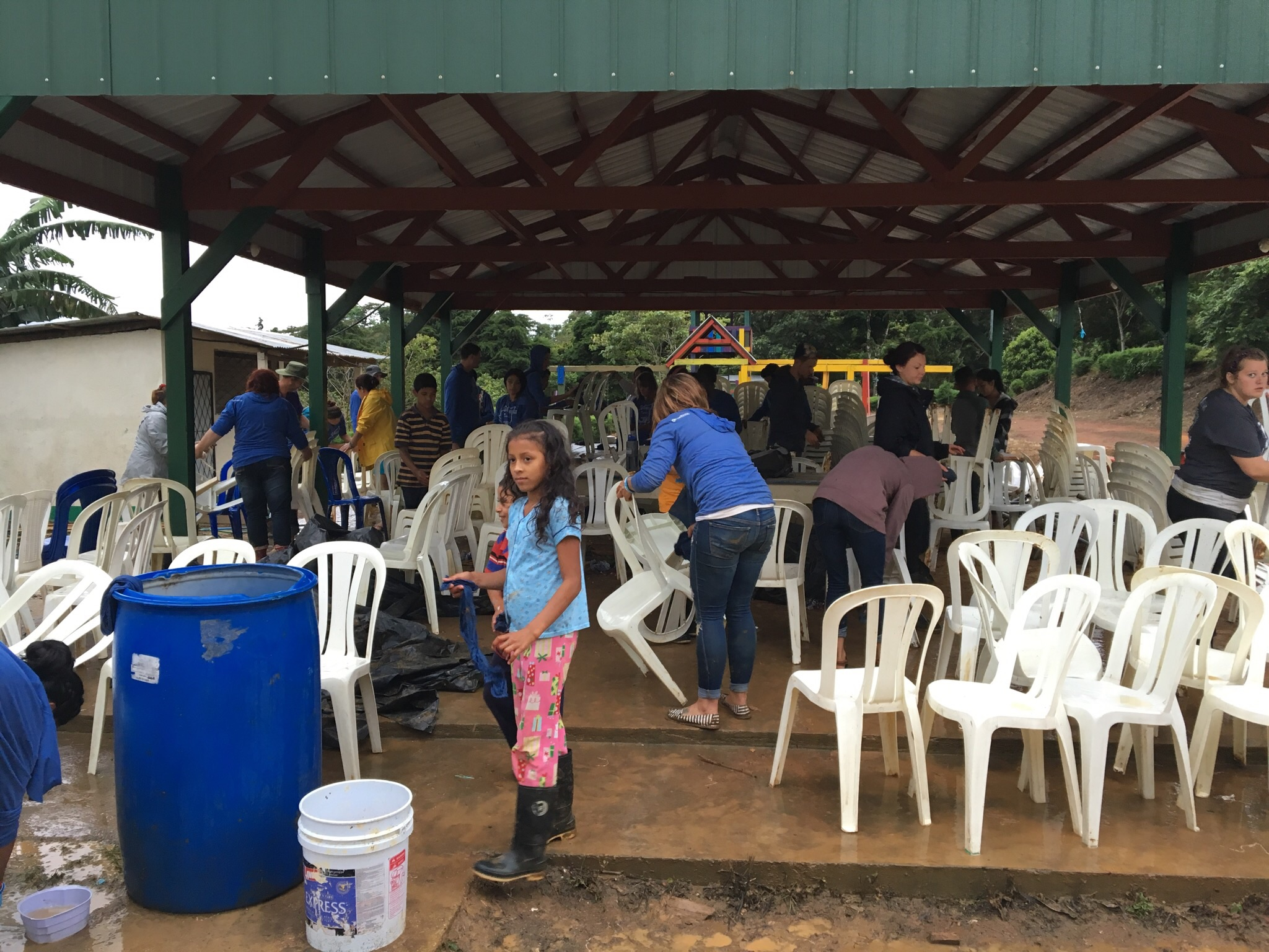The Fox River team is an amazing group of servants. Their final difficult chore was to clean all the mud off the rental chairs so they could be returned.