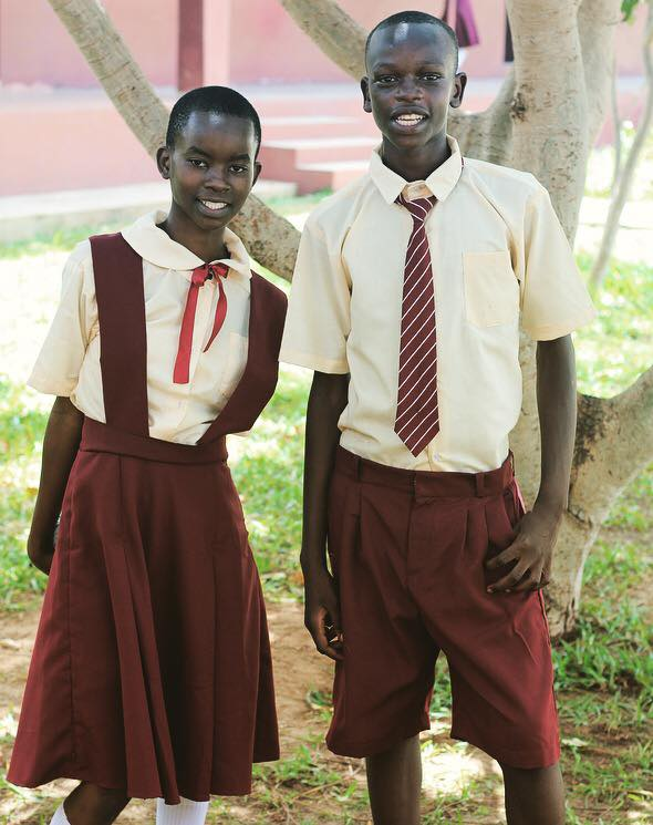 Example of uniforms for older girls and boys. I heard that the boys had a lot of fun learning how to tie a tie!
