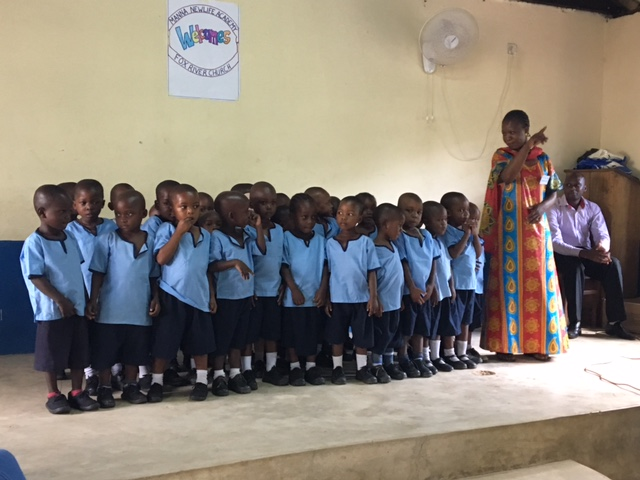 The baby class (3 year olds) singing for us.