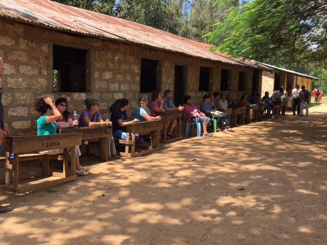 Our team sitting outside one of the classroom buildings during the assembly.