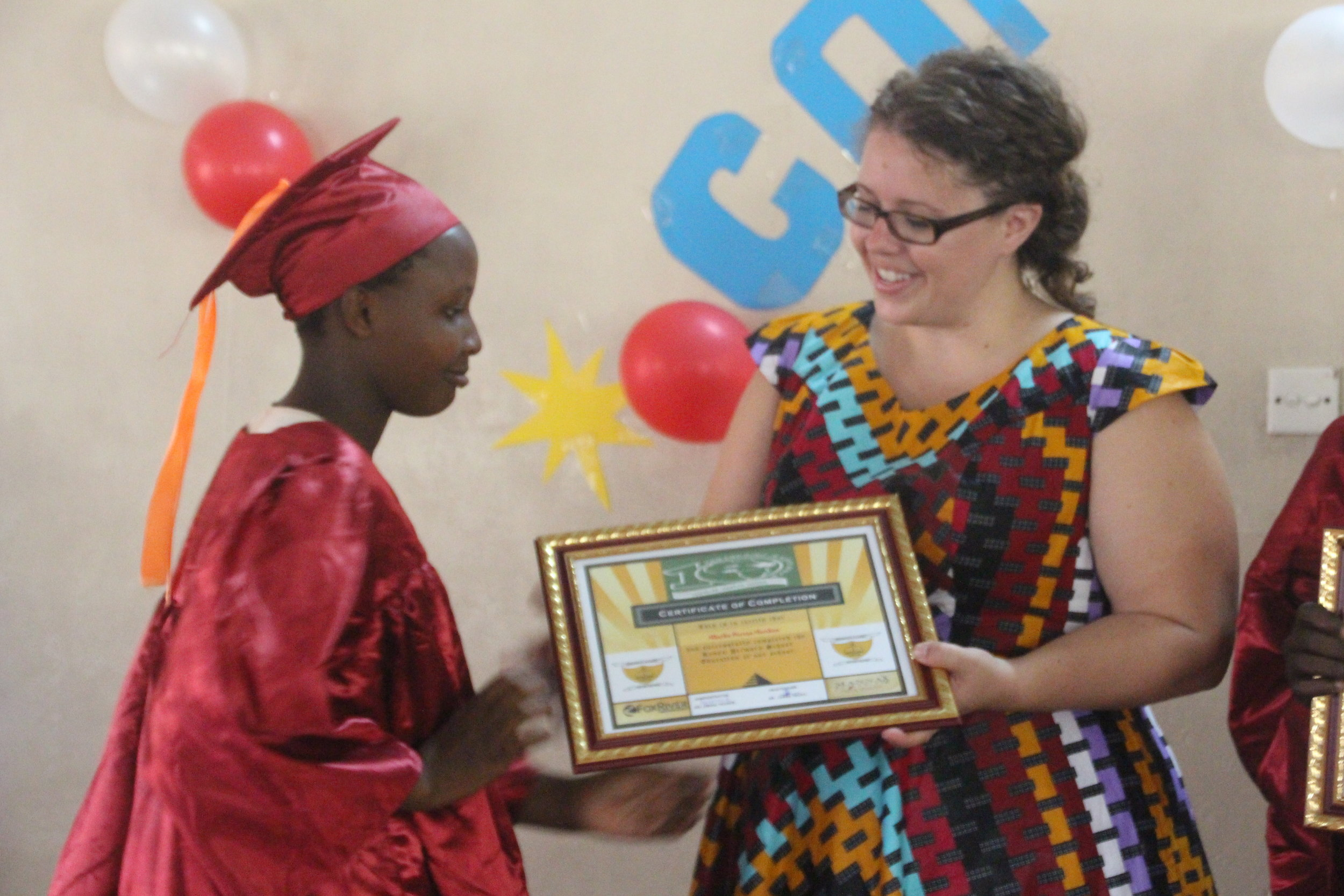 Receiving their certificate of completion
