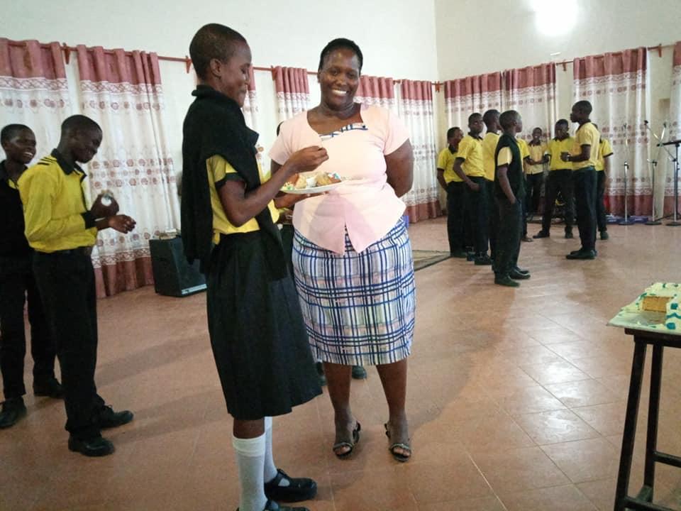 Principal Eve enjoying a bite of the goodness of the celebration cake