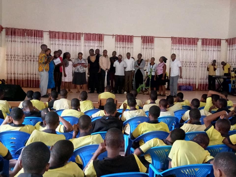 Teacher doing a song in celebration of Gods goodness.