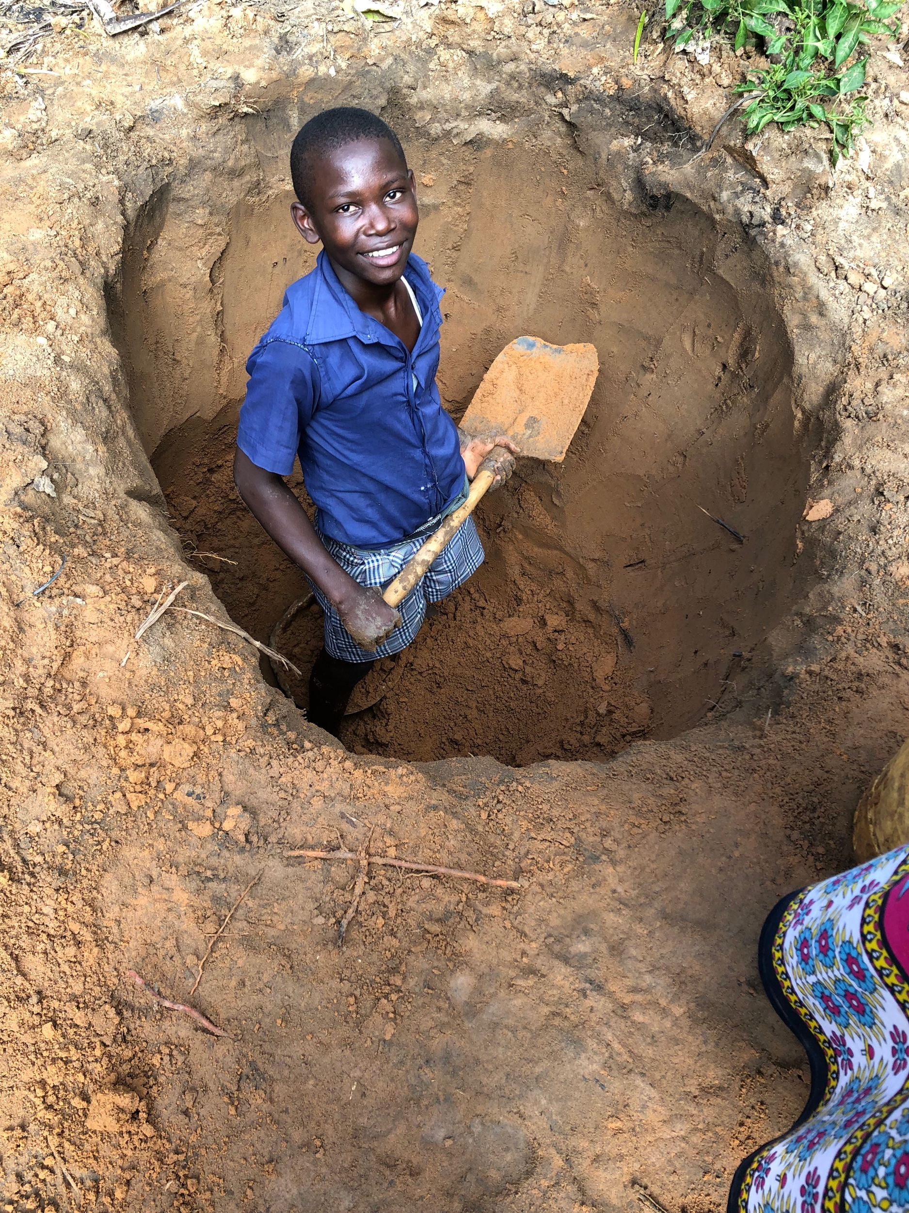 The hole left behind after the dirt was hauled away to be turned into mud. They will use the hole as a compost pile or pit latrine.