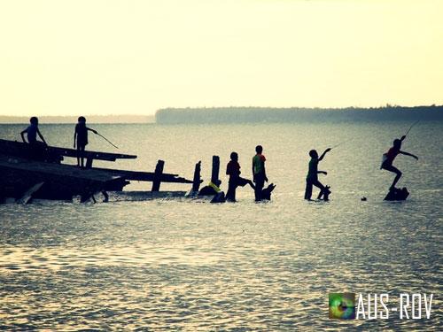 Papua New Guinea Local Island of Daru Children Fishing.