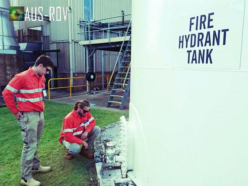 AUS-ROV's tank technicians conducting external general visual inspection.