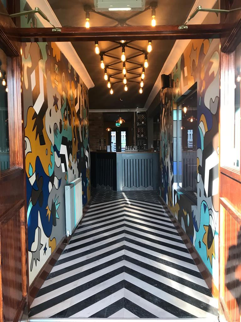 2. Bespoke Art & chevron floor in entrance - Artist Nicolas Dixon - 2.jpeg