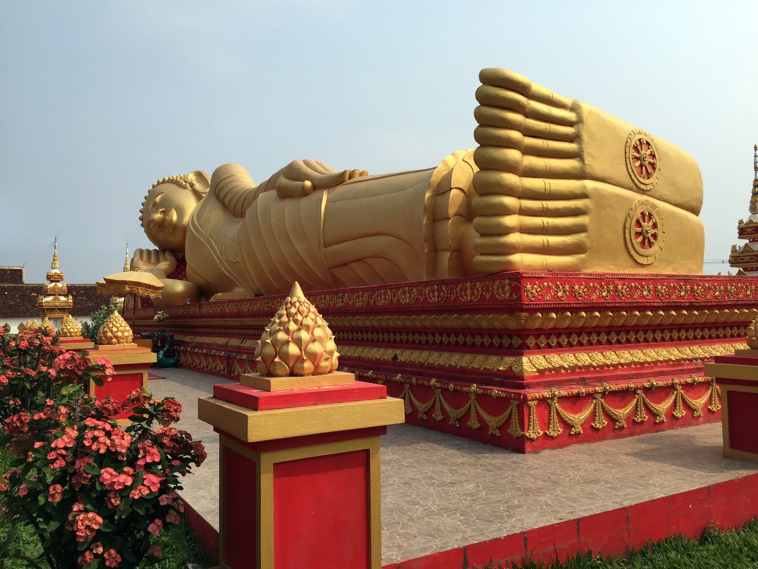See incredible sites like the Reclining Buddha