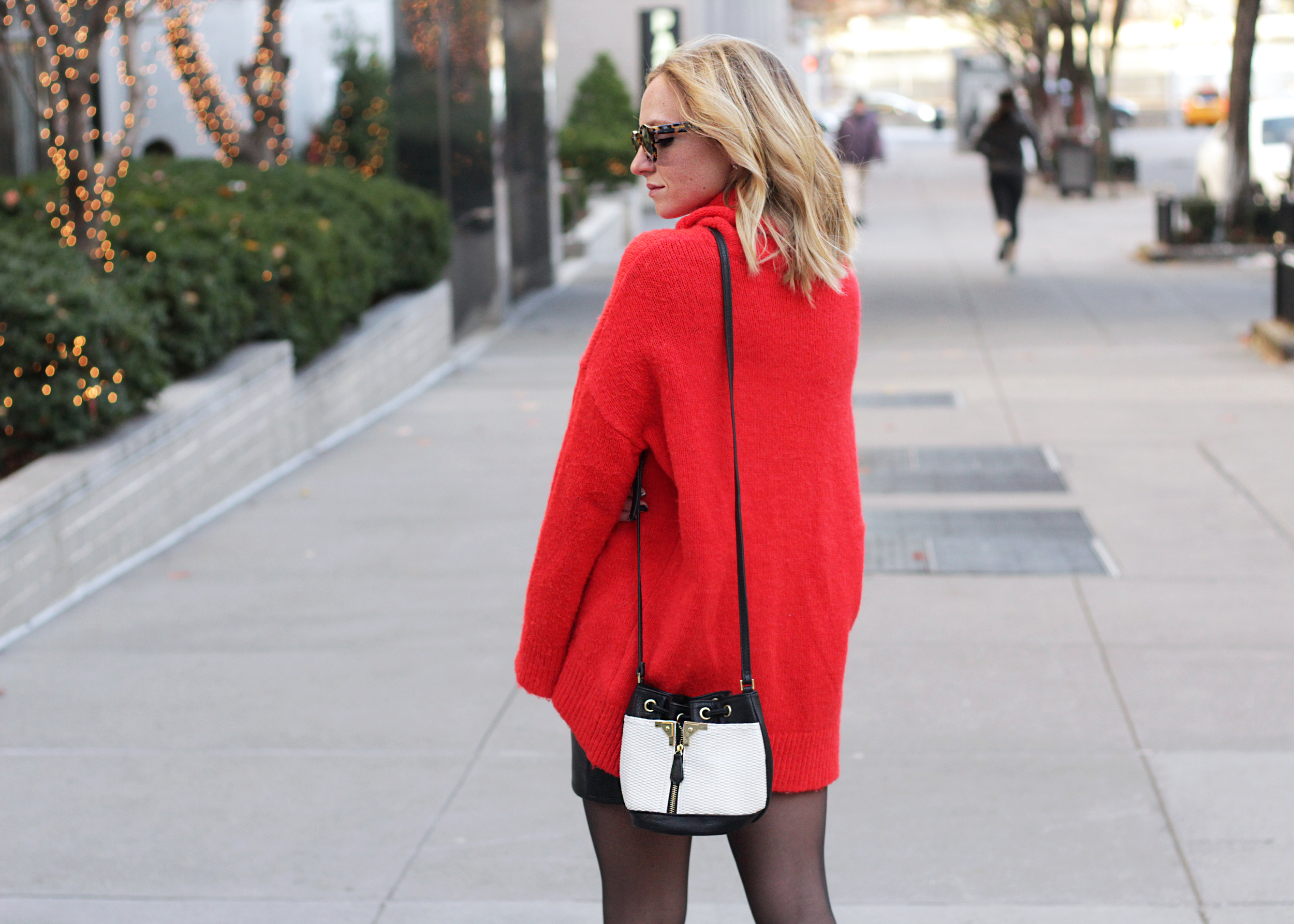 big red sweater skirt and tights outfit bucket bag