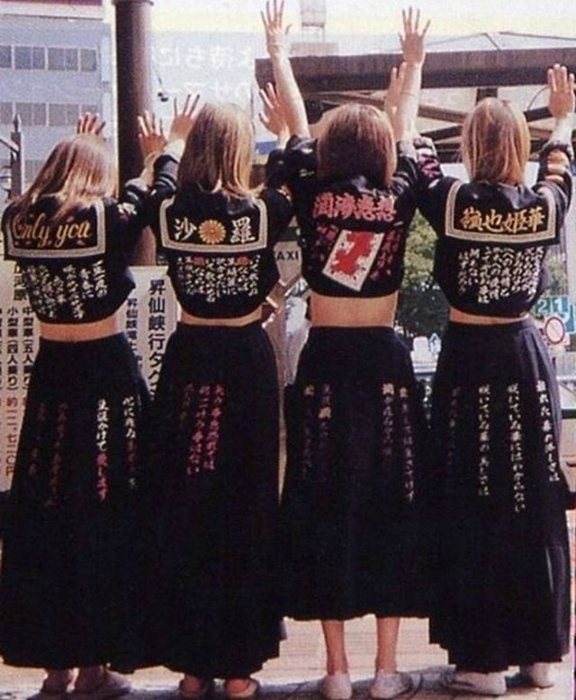 """Japanese schoolgirl uniforms represented rebellion and individualism in the 60s way before it was repurposed for Lolita-focussed male fantasies. 'Sukeban' (meaning 'Girl Boss') gangs were an all out subculture rebellion on the conforms of society. And they were violent.  They disrupted the uniform as a symbol of tradition by scruffily wearing skirts long, sailor blouses hacked to the waist and converse. As graduates they continued to wear the uniform, but embroidered roses and anarchickanji character messages onto the fabric. Interestingly this was also happening within the emerging punk scene in the UK; school blazers being cut up, customised and emblazoned with anarchist slogans. Unfortunately between kitsch crime fighter themed TV and """"Pink Films"""" like 'Delinquent Girl Boss' and 'Terrifying Girls' High School', Sukeban transformed into a sexualised dress still prevalent today."""