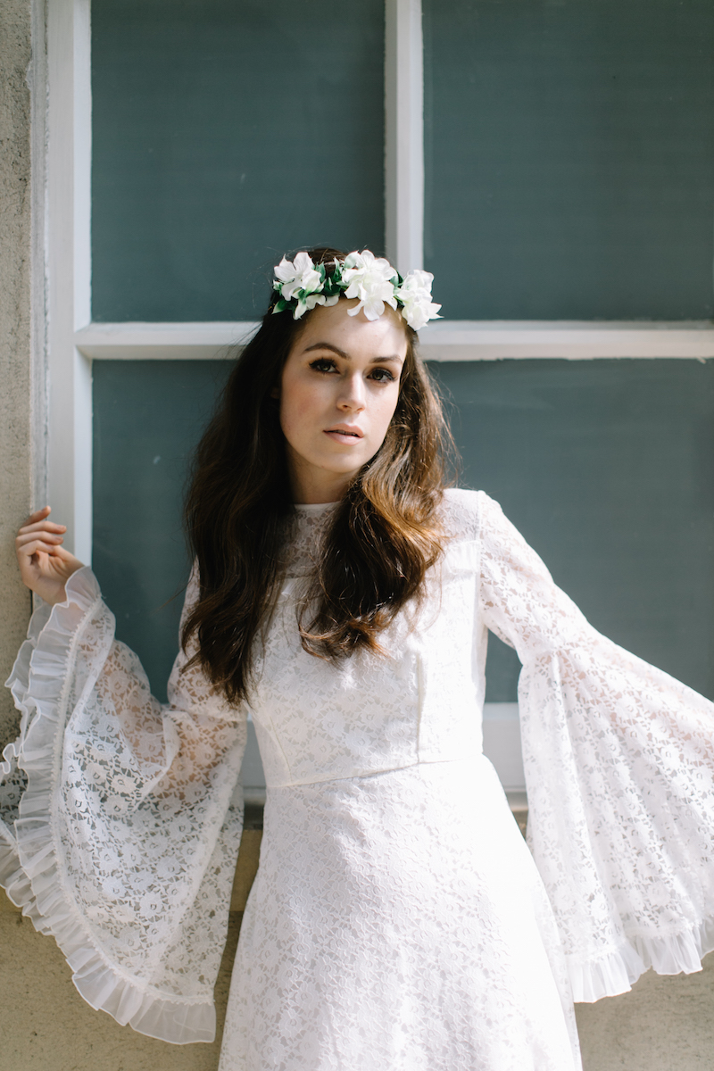 bell sleeved wedding dress and floral crown by Archive 12