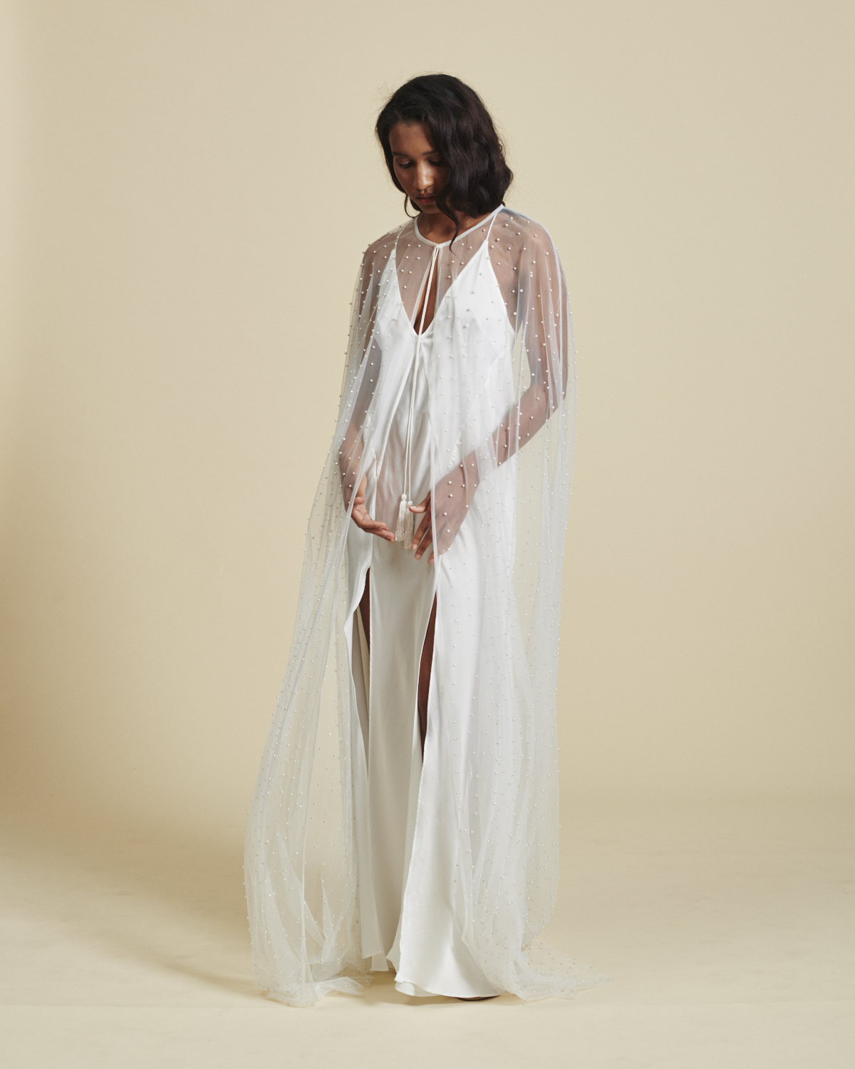 Pearl beaded bridal cape by Daughters of Simone