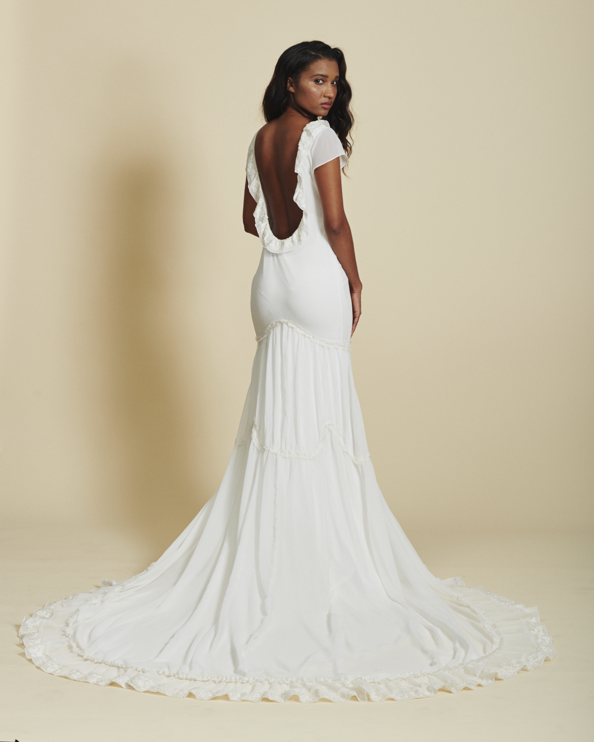 ruffle chiffon wedding dress by Daughters of Simone