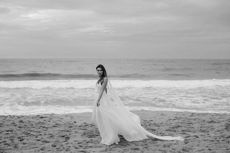floaty beach wedding dress with wings