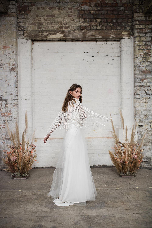 fringed lace boho wedding dress by shikoba bride
