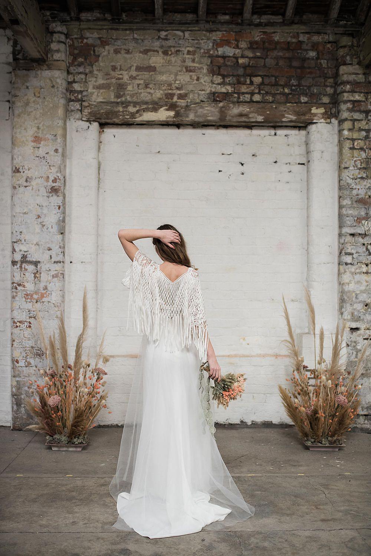 boho lace wedding dress with cape by Shikoba Bride