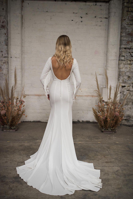 white fringed long sleeve wedding dress