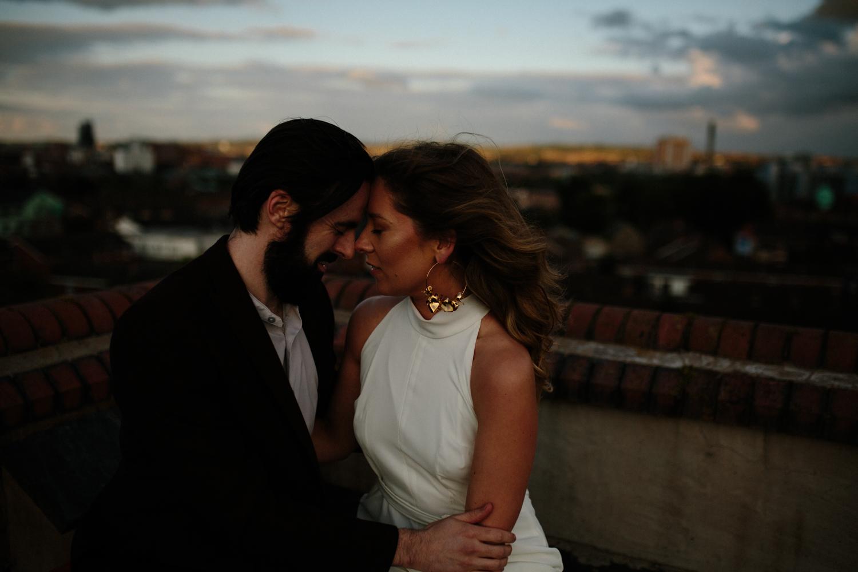 intimate urban couples shoot - Belfast city rooftop