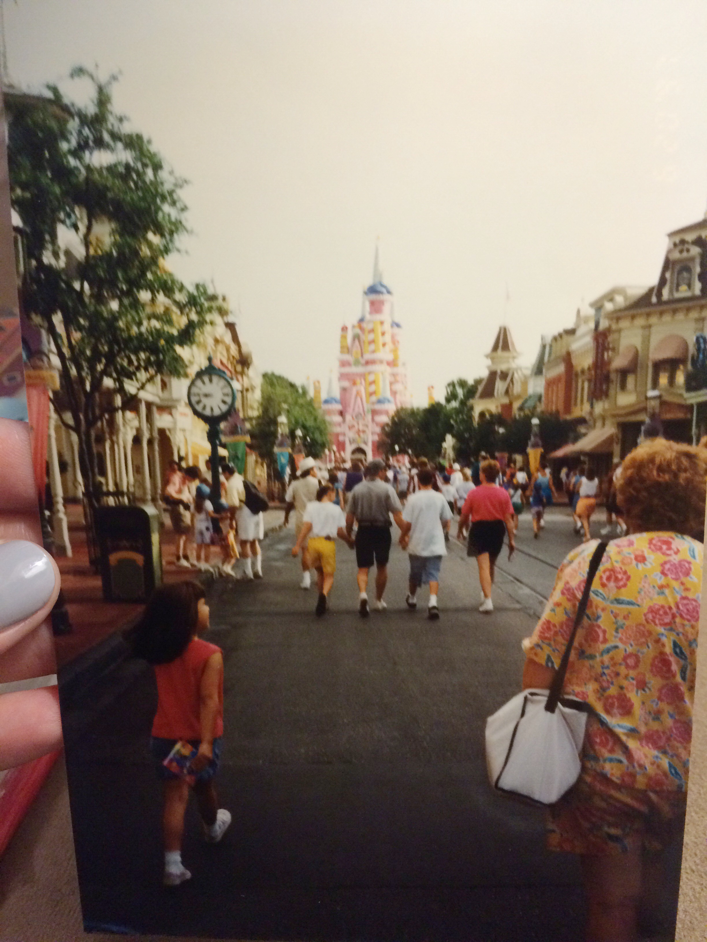 Also, what is now my favorite photo of myself at DIsney that i've found! Just walking casually down Main Street with my Lisa Frank autograph book! And the castle was my favorite way it ever looked!
