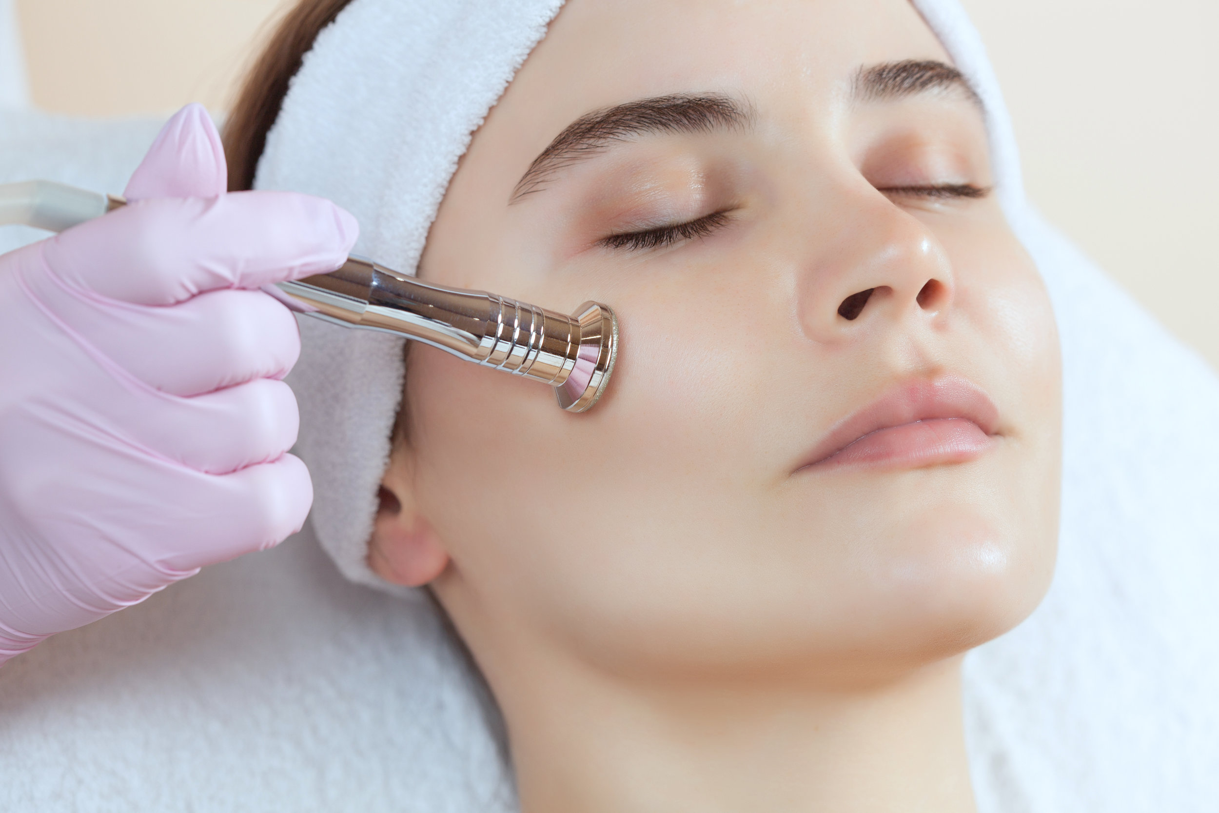 Canva - The cosmetologist makes the procedure Microdermabrasion of the facial skin of a beautiful, young woman.jpg