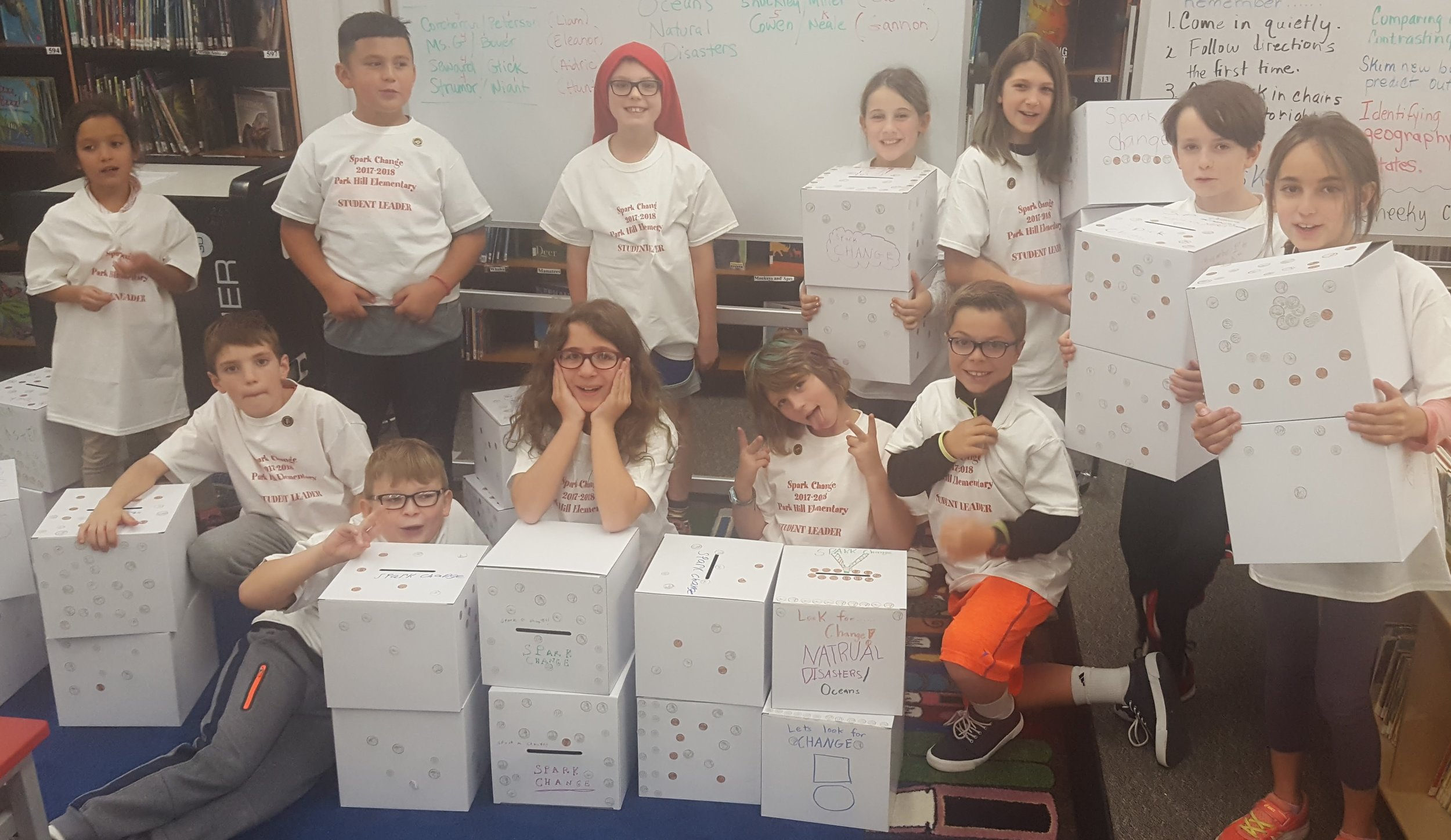 Student Leaders prepare collection boxes for K-5 classrooms.