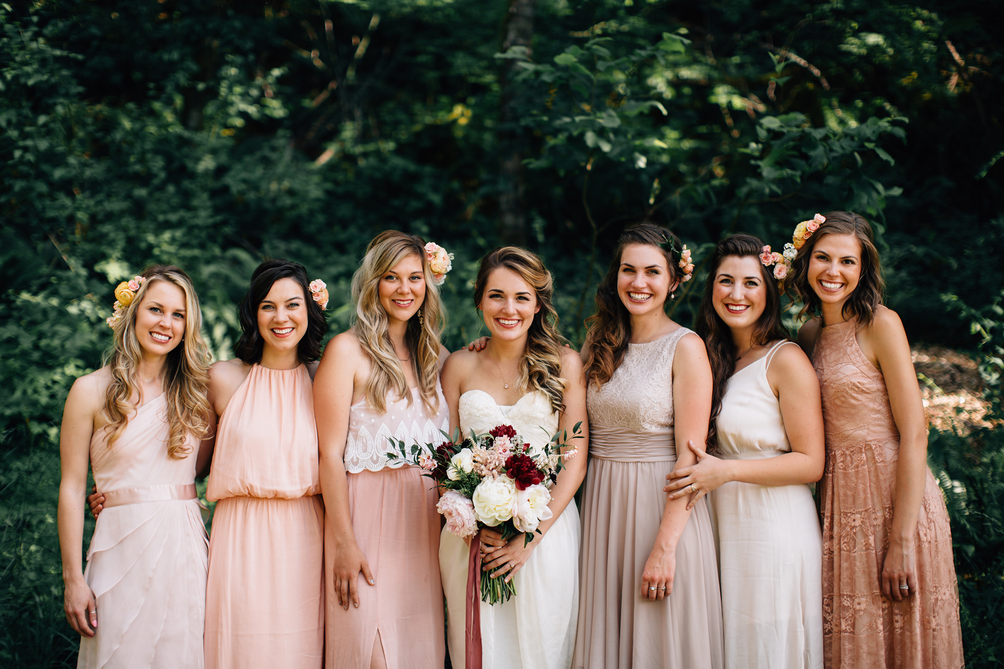 bridesmaids with bridal bouquet and flowers in their hair