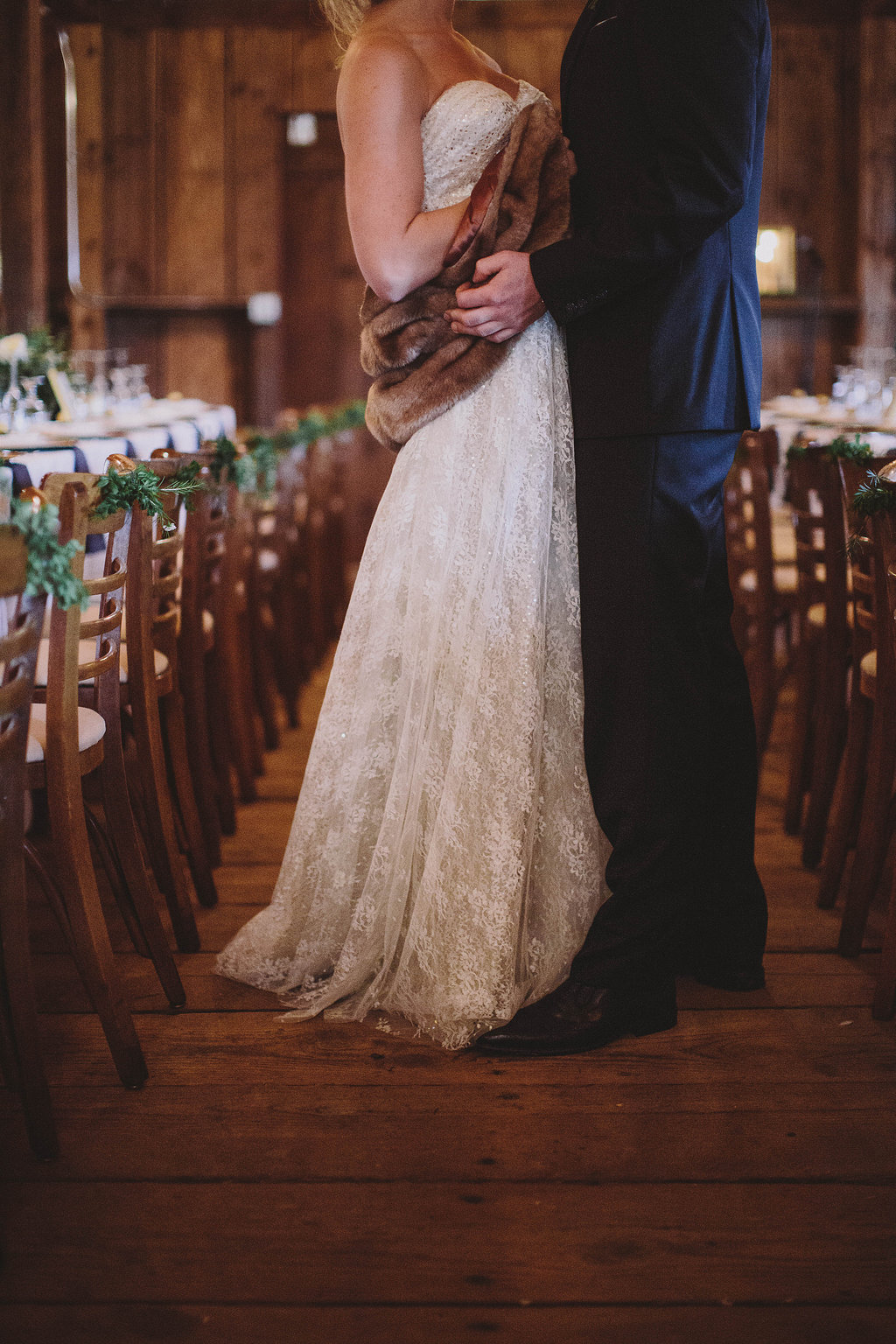 bride and groom in the barn