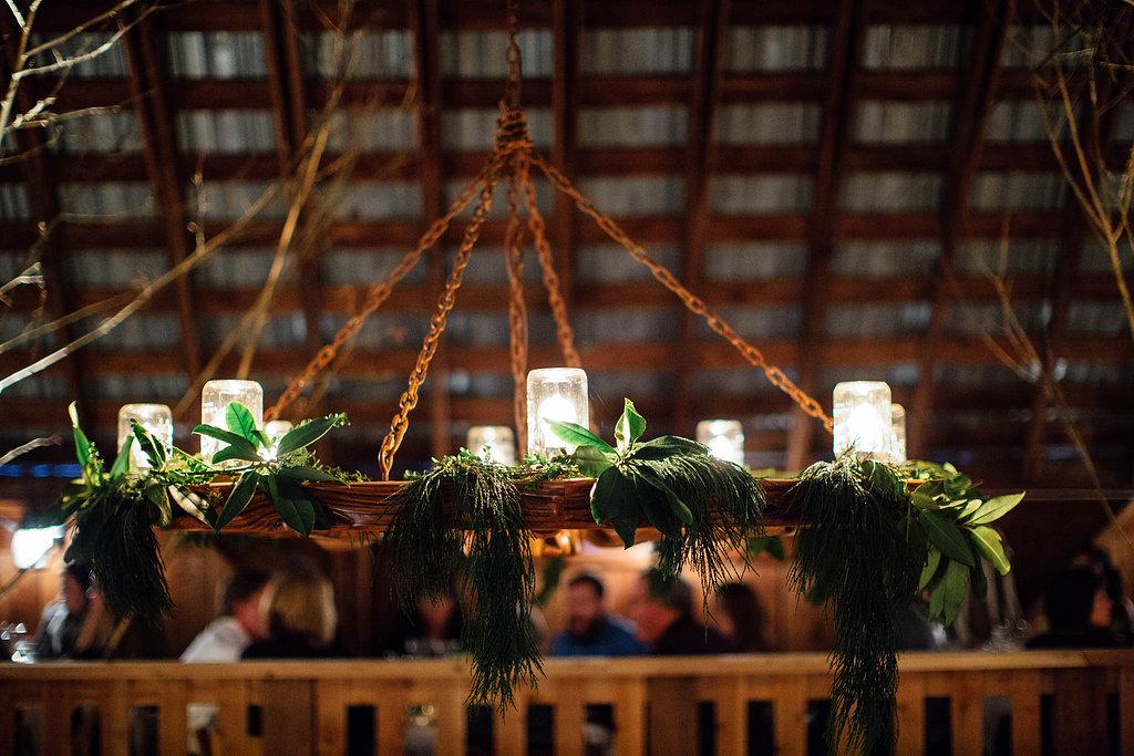 wedding lighting greenery installation
