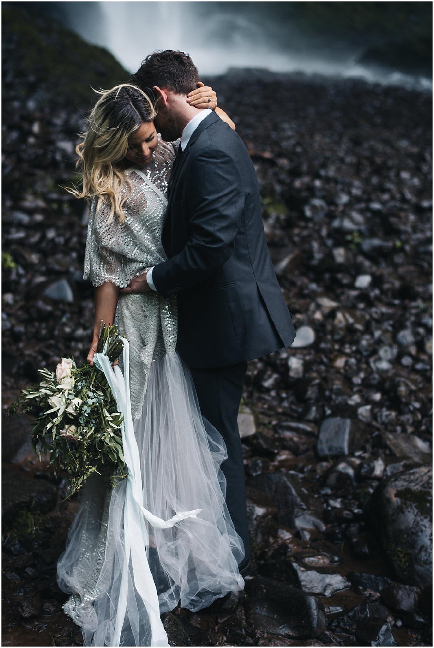 romantic neck kiss with bridal bouquet