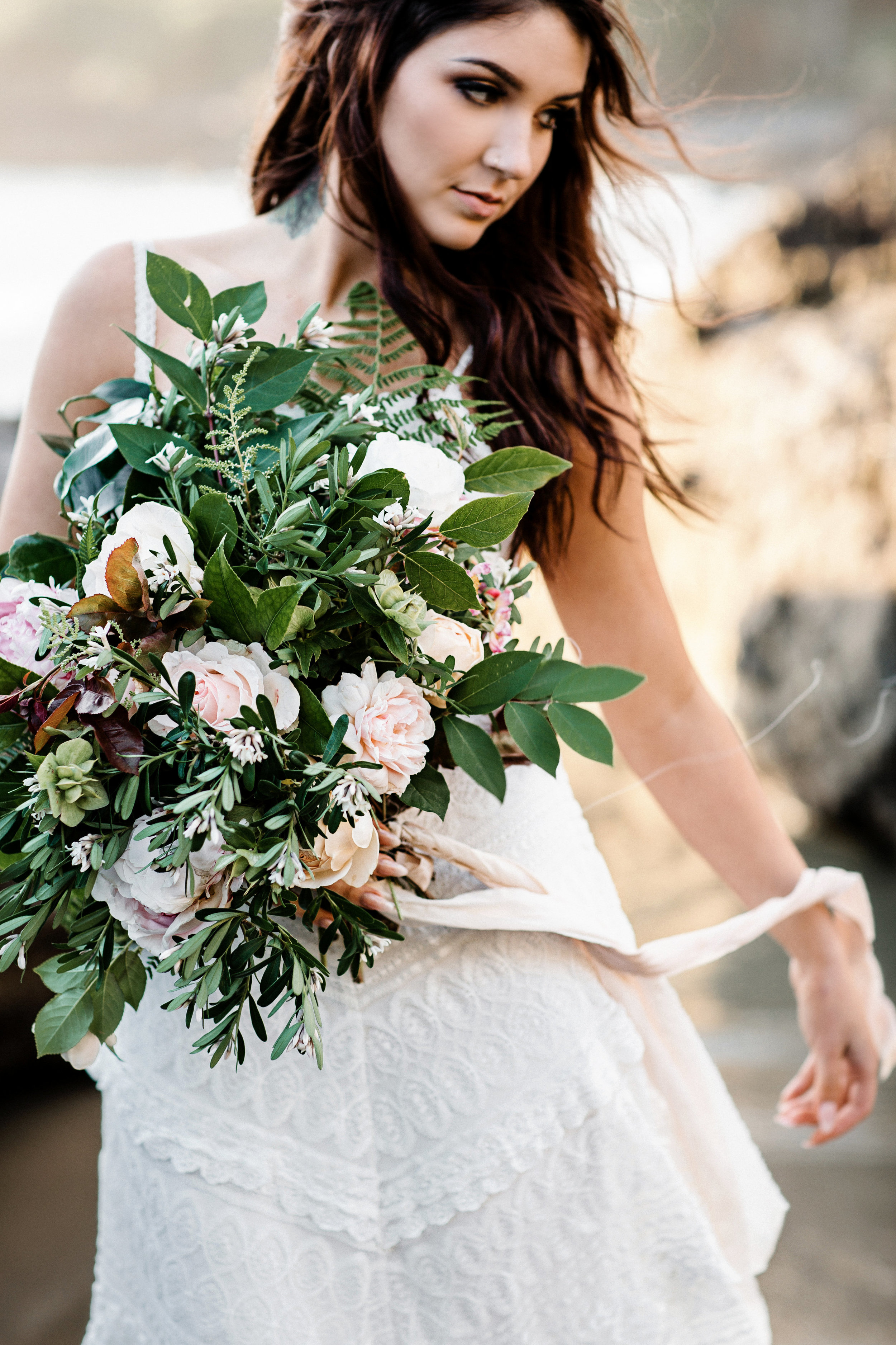 good seed floral design moody beach photoshoot with thick greenery and flowers