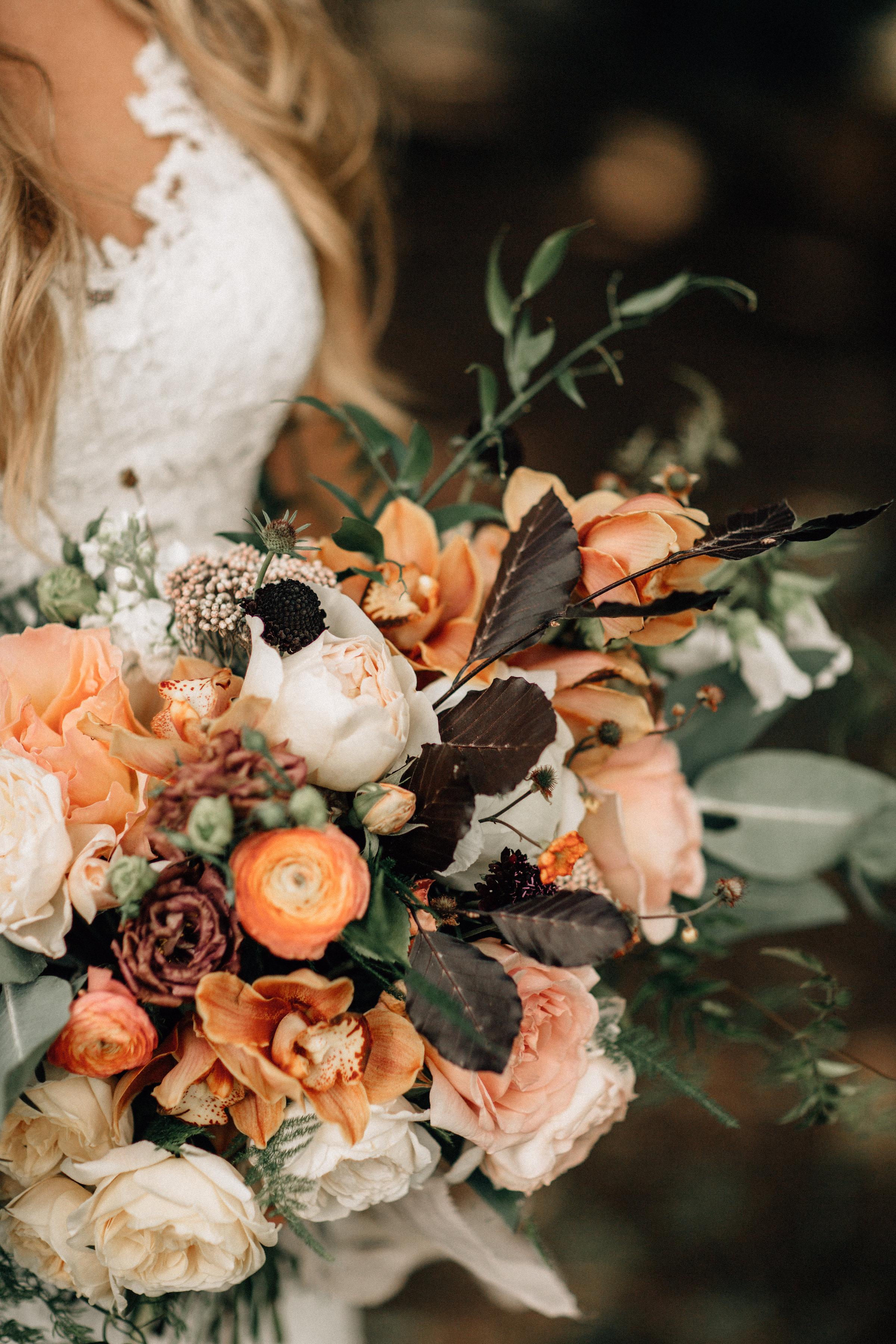 pops of peach wedding flowers