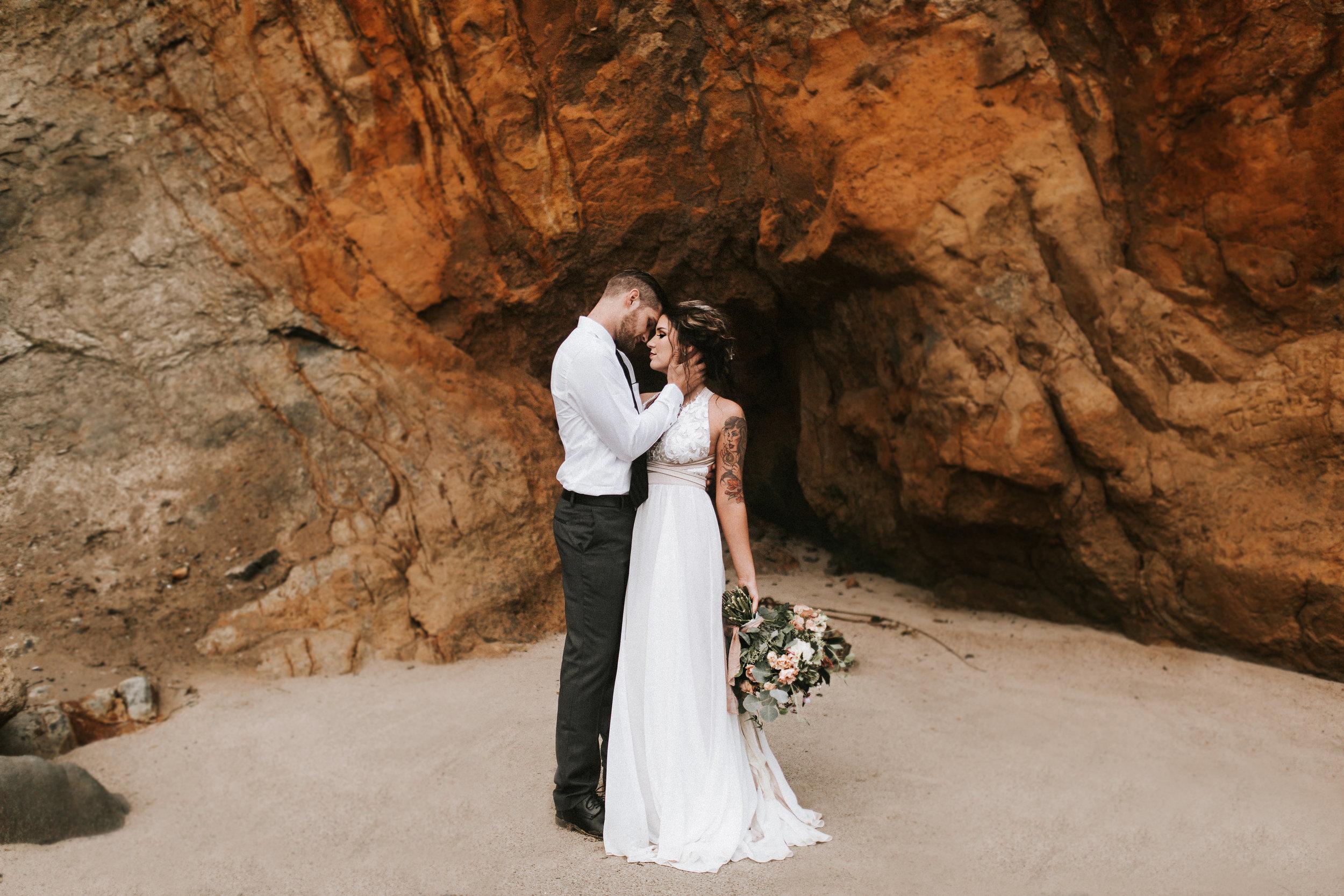 wedding kiss on the rocks