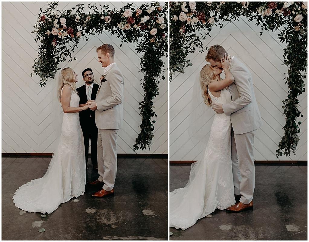 wedding kiss under the arbor