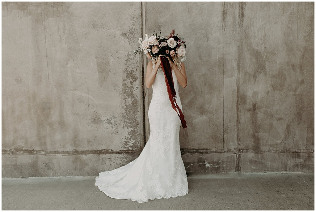 flowers in front of bride