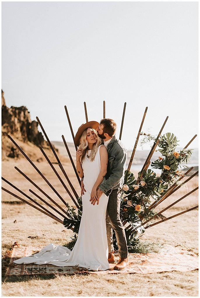 newlyweds kiss on their wedding day