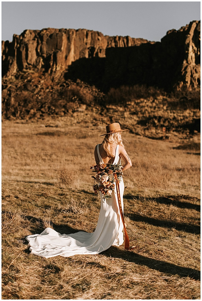 bride alone with flowers