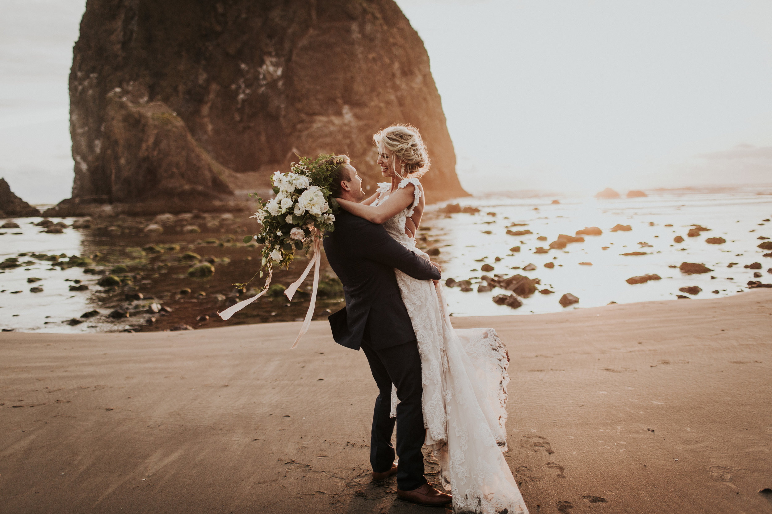 wildly romantic bride and groom on the beach