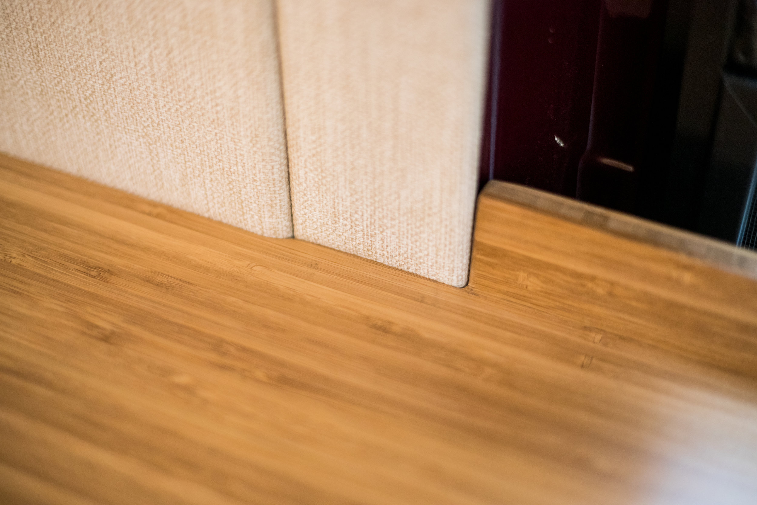 The counter top here was scribed to match the wall panels for consistent aesthetic and a perfect lie against the wall.
